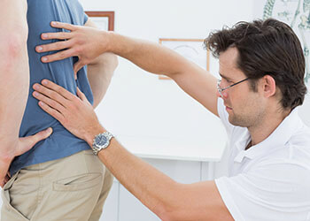 factor back pain causes palm beach